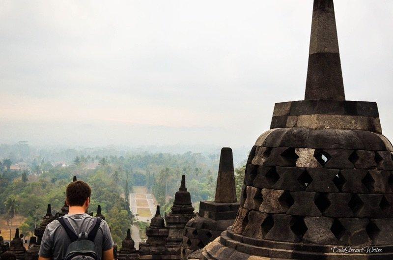 Duke Stewart standing next to a Borobudur Stupa, Indonesia