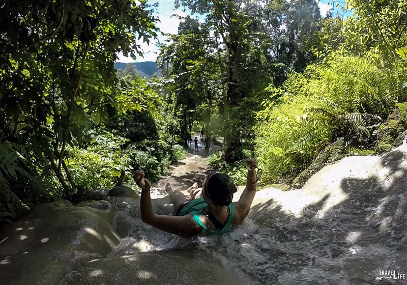 Acting Like a Waterslide at Bua Thong Sticky Waterfalls Thailand