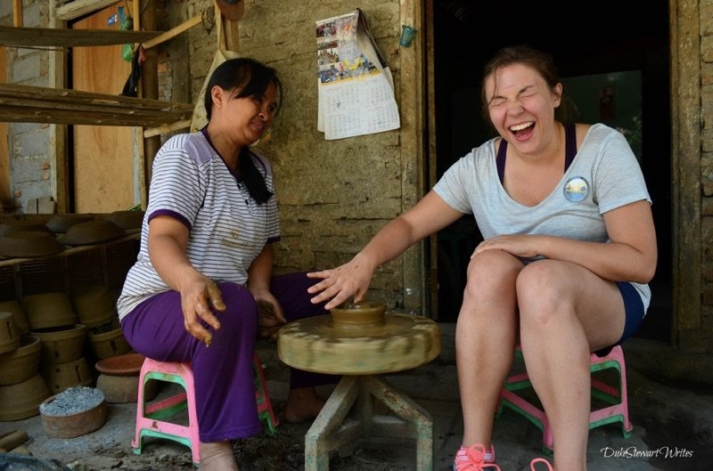 Christina making pottery at a clay village near Borobudur Temple in Indonesia