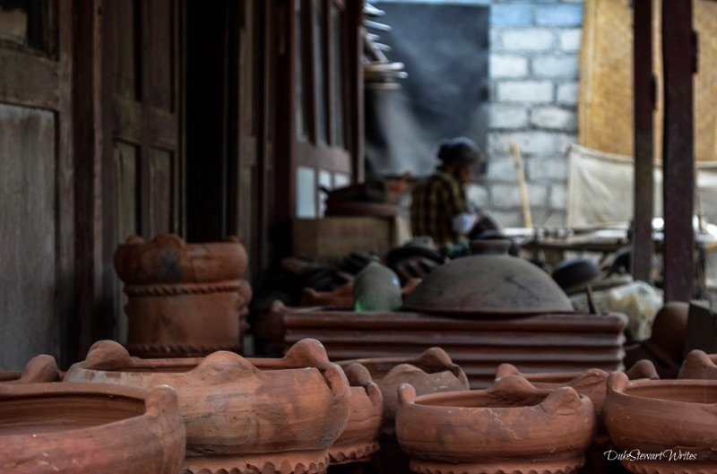 Clay Pots and a Woman making them in the background, Indonesia