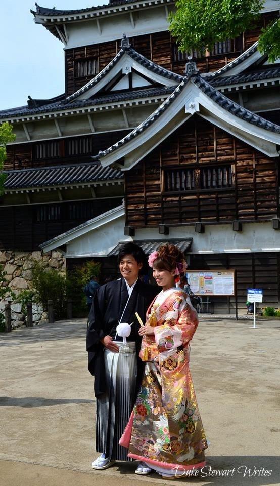 Couple outside Hiroshima Castle, Japan