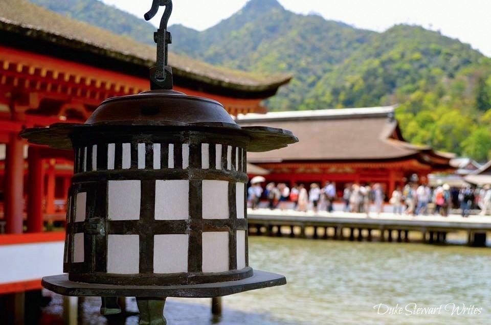 Lantern and Itsukushima Shrine on Miyajima, Japan