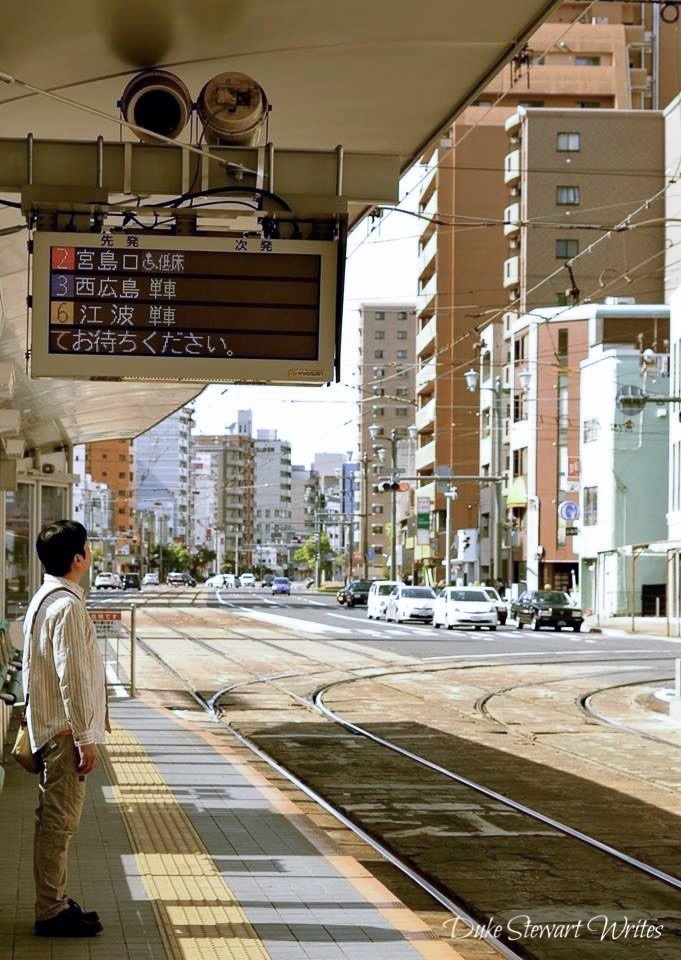 Waiting for a Streetcar to arrive in Hiroshima, Japan