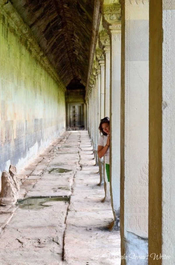 Christina Inside Angkor Wat exterior wall