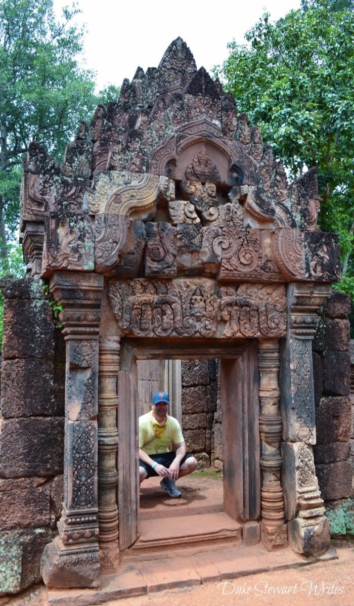 Crouched down at Banteay Srei near Angkor, Cambodia