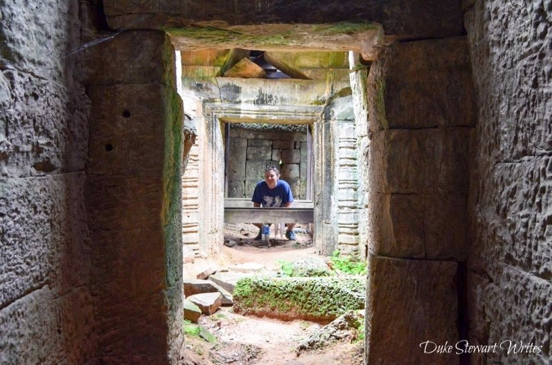 Crowching around the East_Mebon Complex near Angkor, Cambodia
