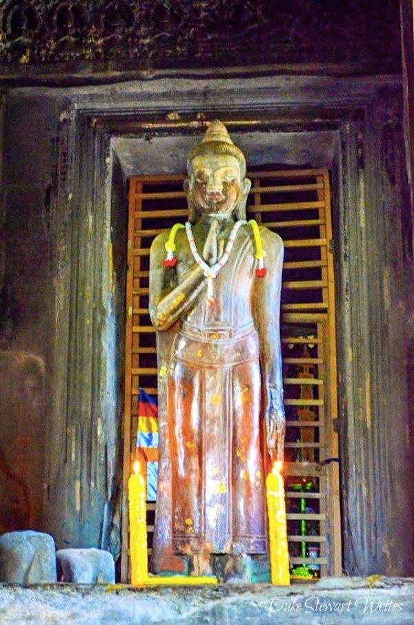 Discolored Buddha Statue inside Angkor Wat