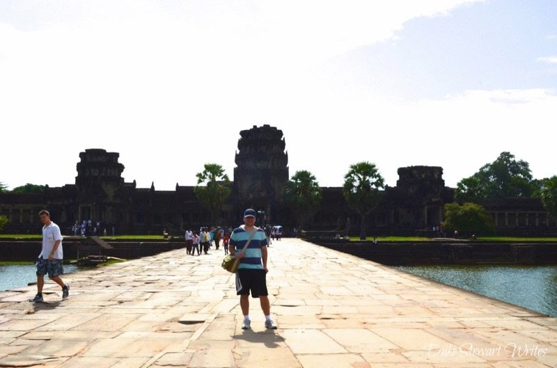 Duke Stewart Standing in front of the exterior wall as we walk across the Angkor Wat moat