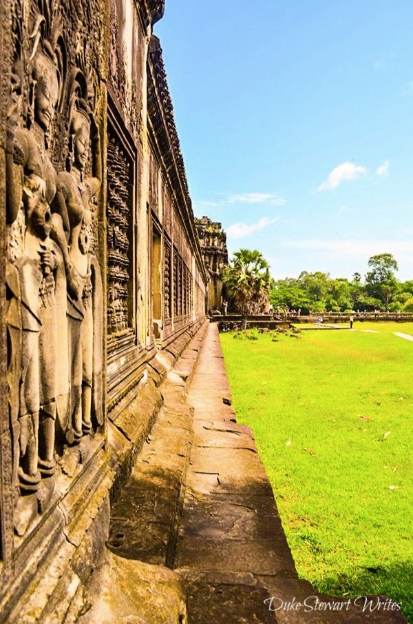 Inside the Angkor Wat complex and carvings on the outer wall