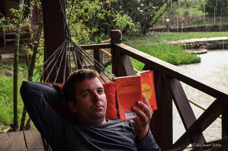 Duke Stewart reading the Alchemist in Thailand