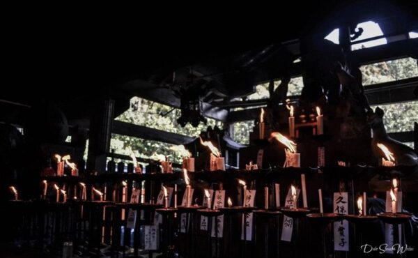 Lighting Candles in Fushimi Inari Temple Kyoto